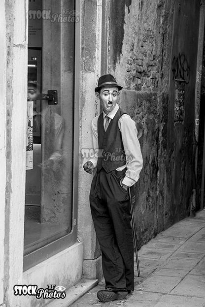 a street artist imitates Charlie Chaplin in Venice